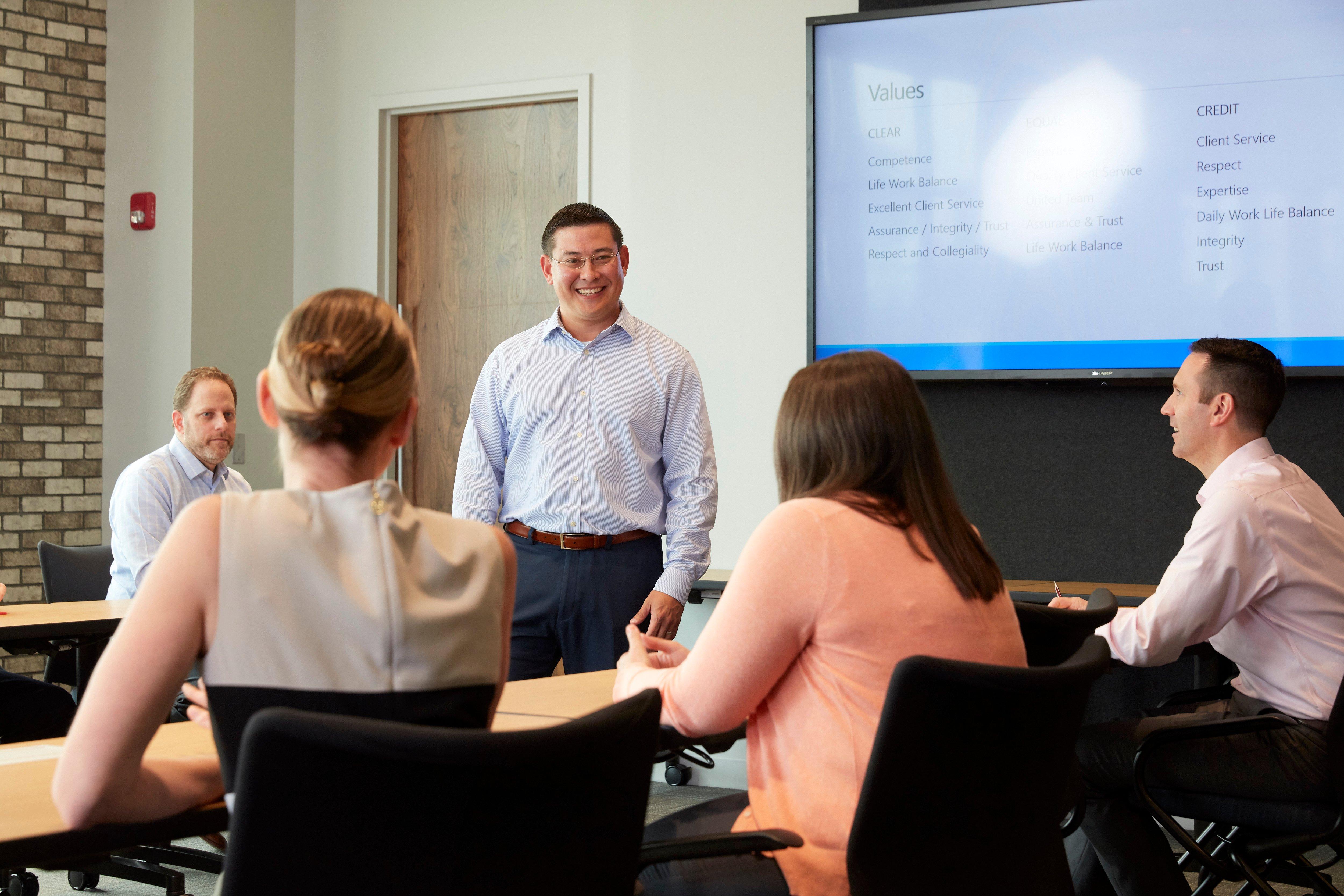 Mike Little of GGM Wealth Advisors presents to Gross Mendelsohn staff members