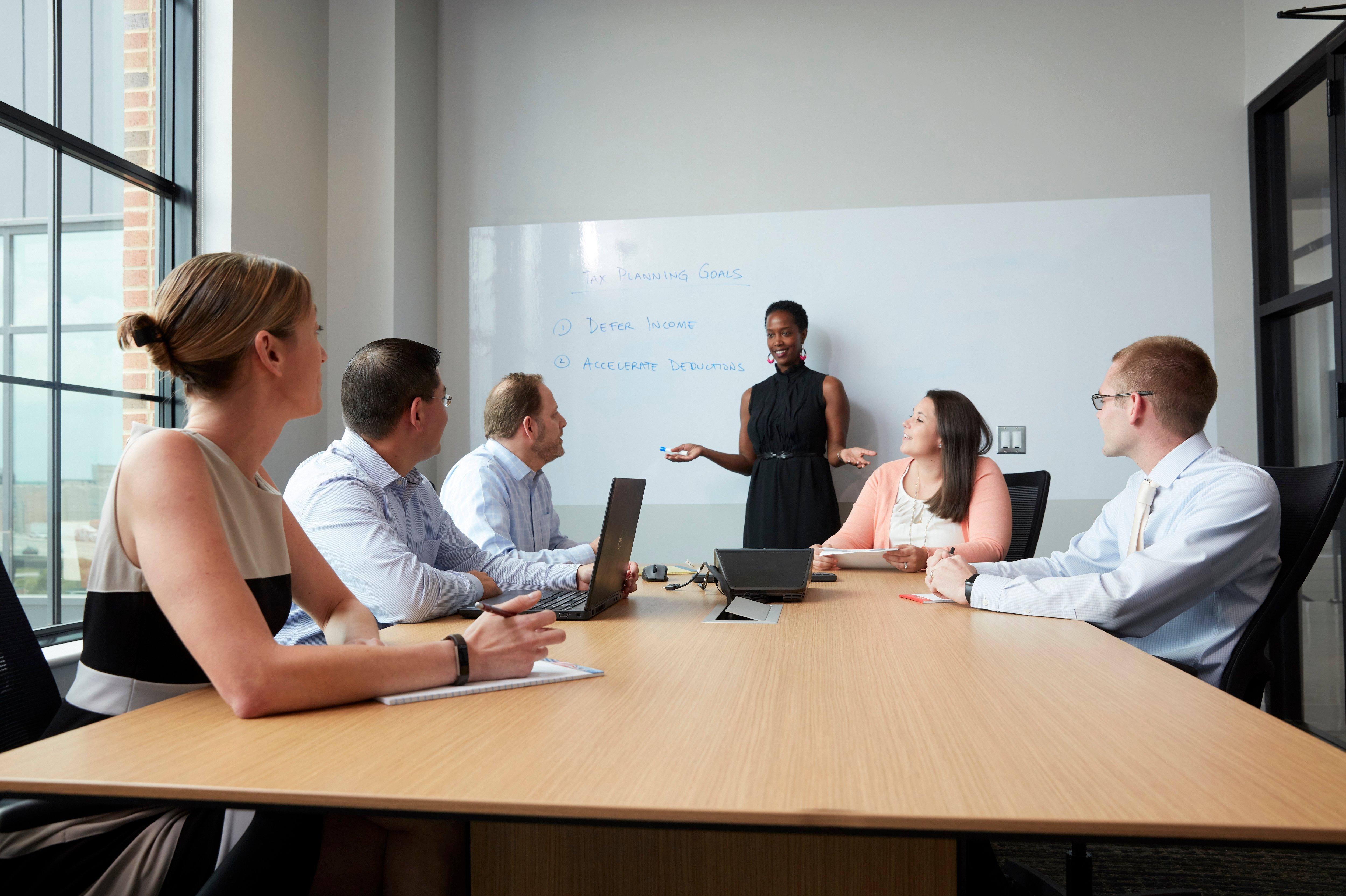 Gross Mendelsohn employees in a meeting