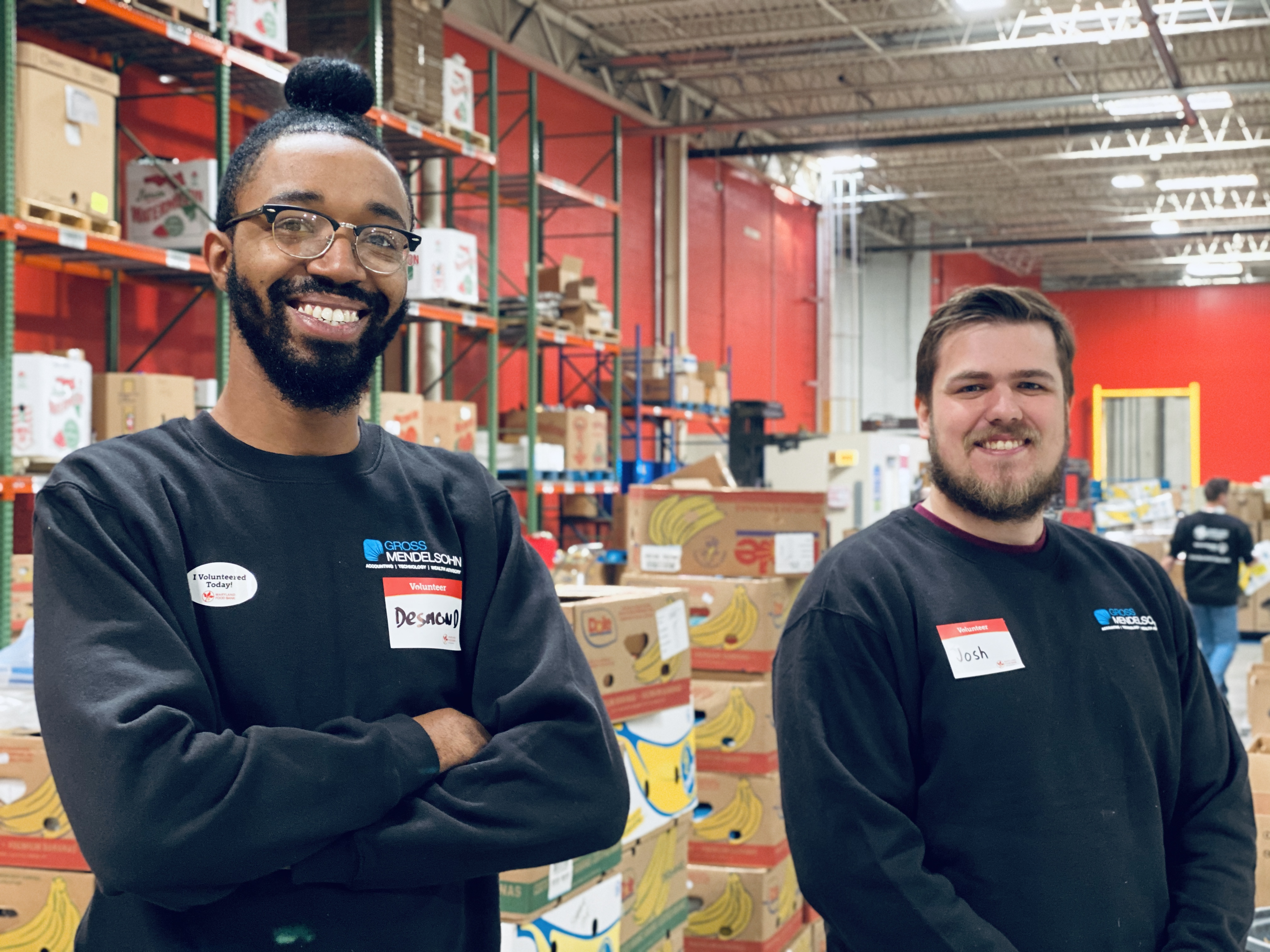Desmond Baptiste and Joshua Council volunteer at Maryland Food Bank