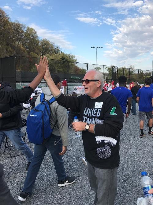 Steve Rostek volunteering at Special Olympics Maryland tennis tournament