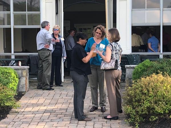 women networking at Gross Mendelsohn Maryland Construction Network seminar